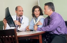 doctor with patients discussing incorrect diagnosis