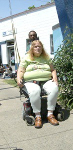 woman inwheelchair being discharged from hospital